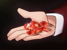 宝石を持つ手