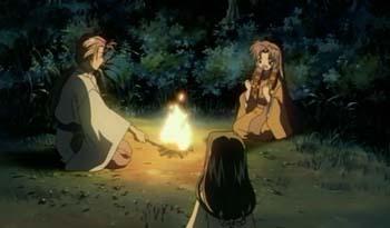 焚火を囲む三人