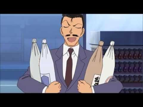 両手にお酒を抱える小五郎